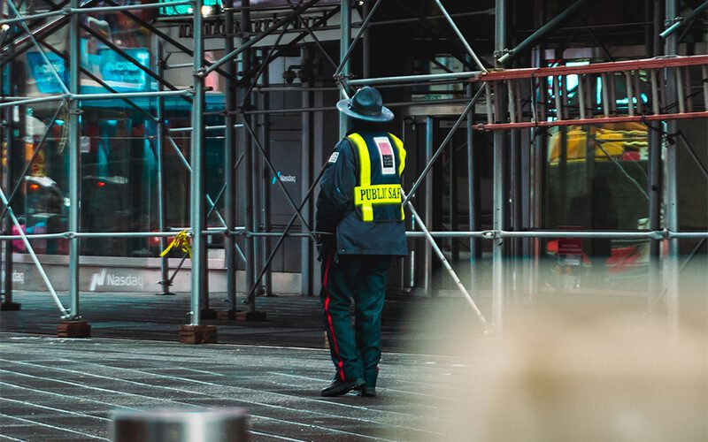 firefighter standing in front of scaffolding in NYC
