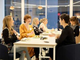 women sitting around a meeting table