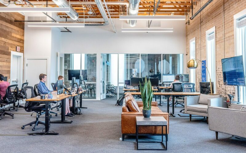 an office space with people sitting at desks.
