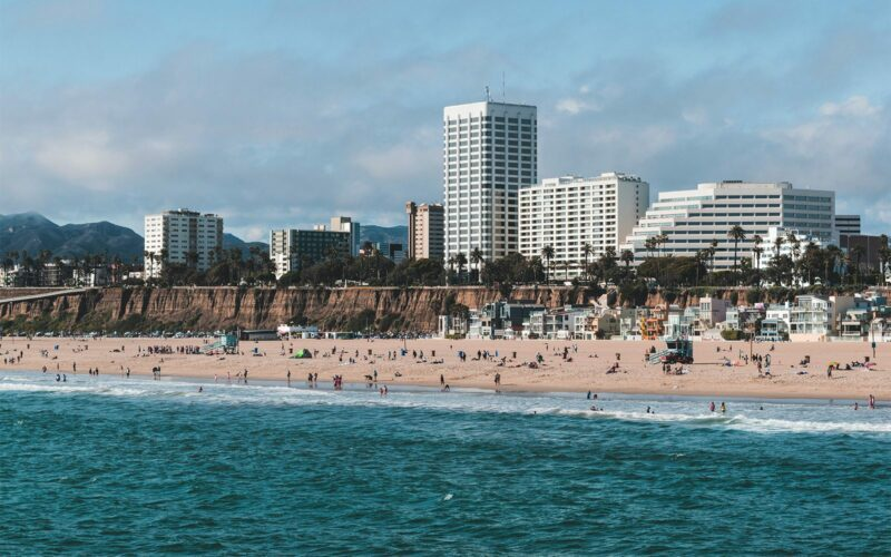a beach with buildings overlooking the water