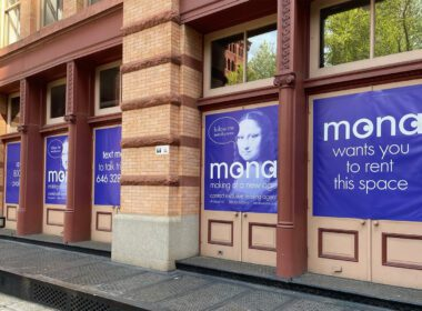MONA advertisement on the front of a building