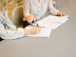 two women filling out an application for a zoning permit