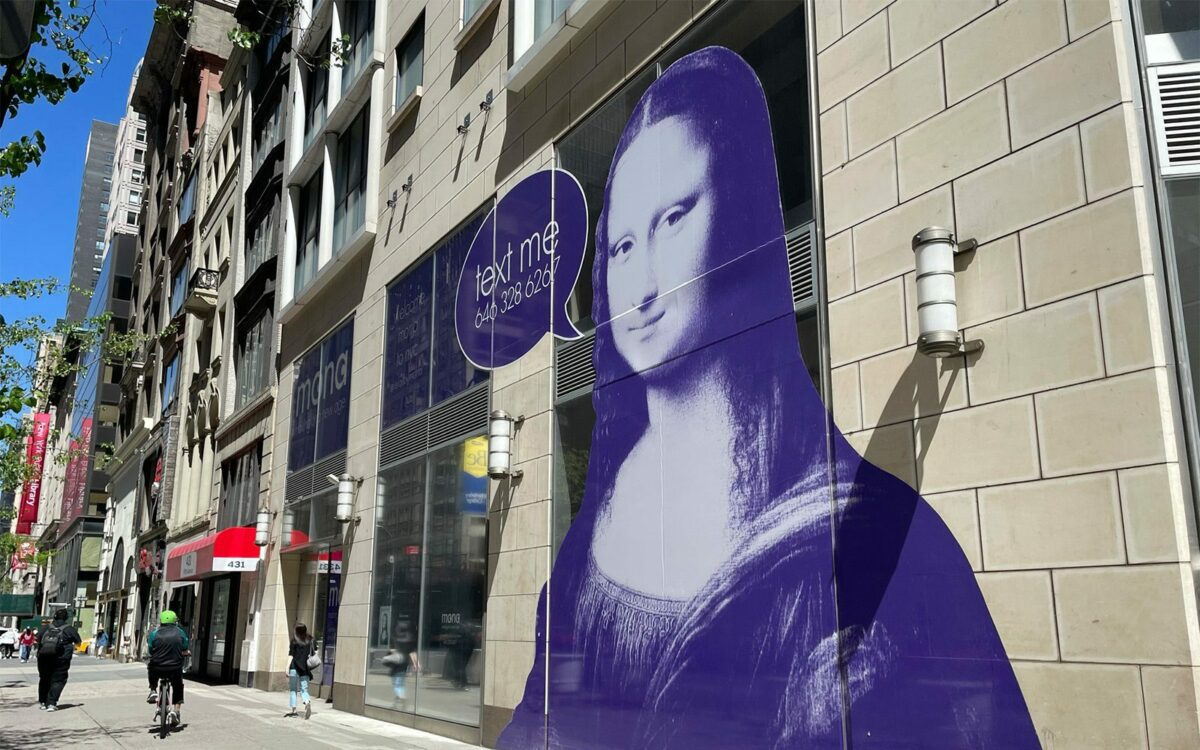 MONA advertisement on the side of a building in NYC