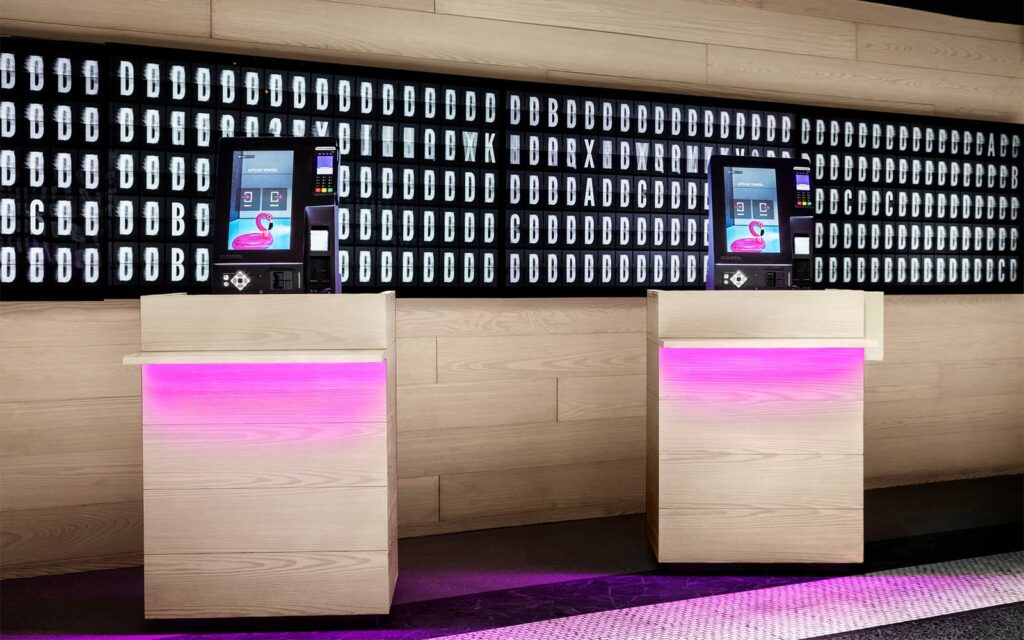 A hotel lobby with contactless check in stations.
