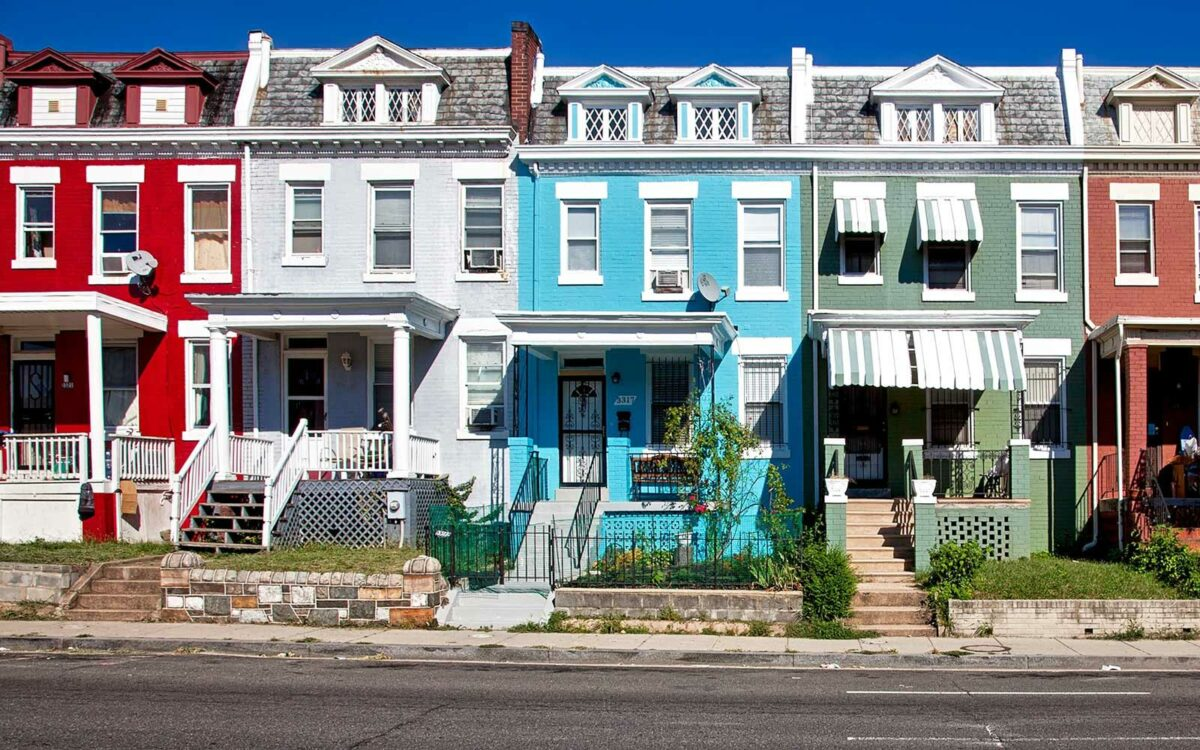 A row of houses sit on a developing street.