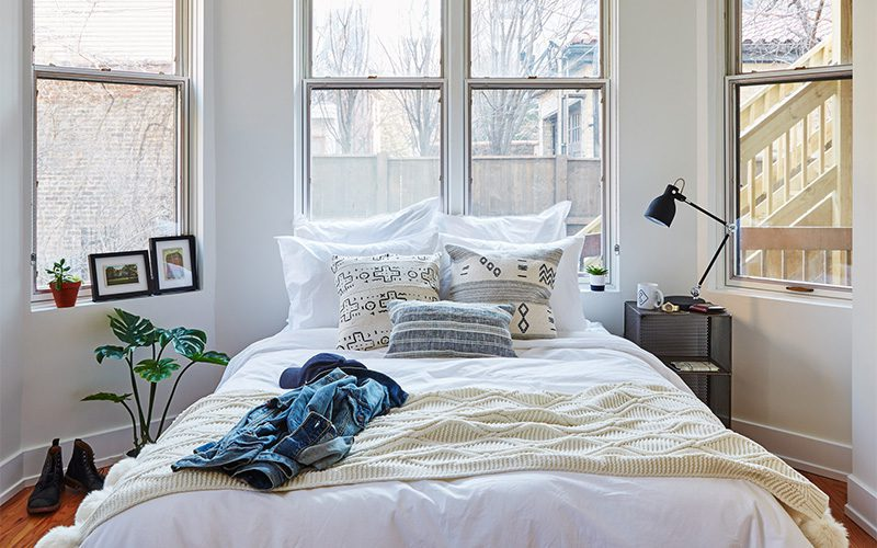 The bedroom of a Common work-living space on display.