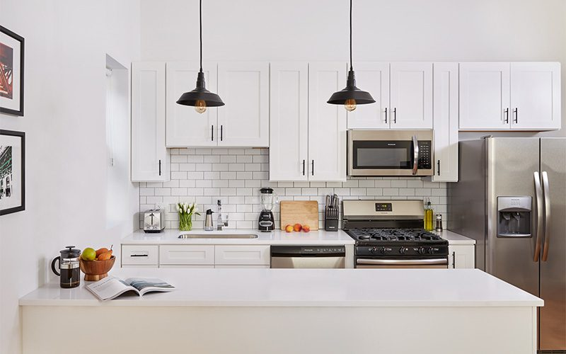 The kitchen of a Common work-living space on display.