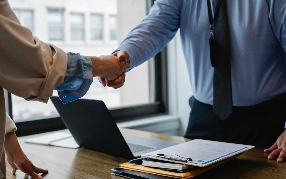 A handshake deal is arranged in an office.